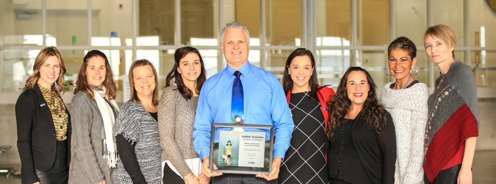 Mike Soligo receives SickKids certificate of acknowledgement