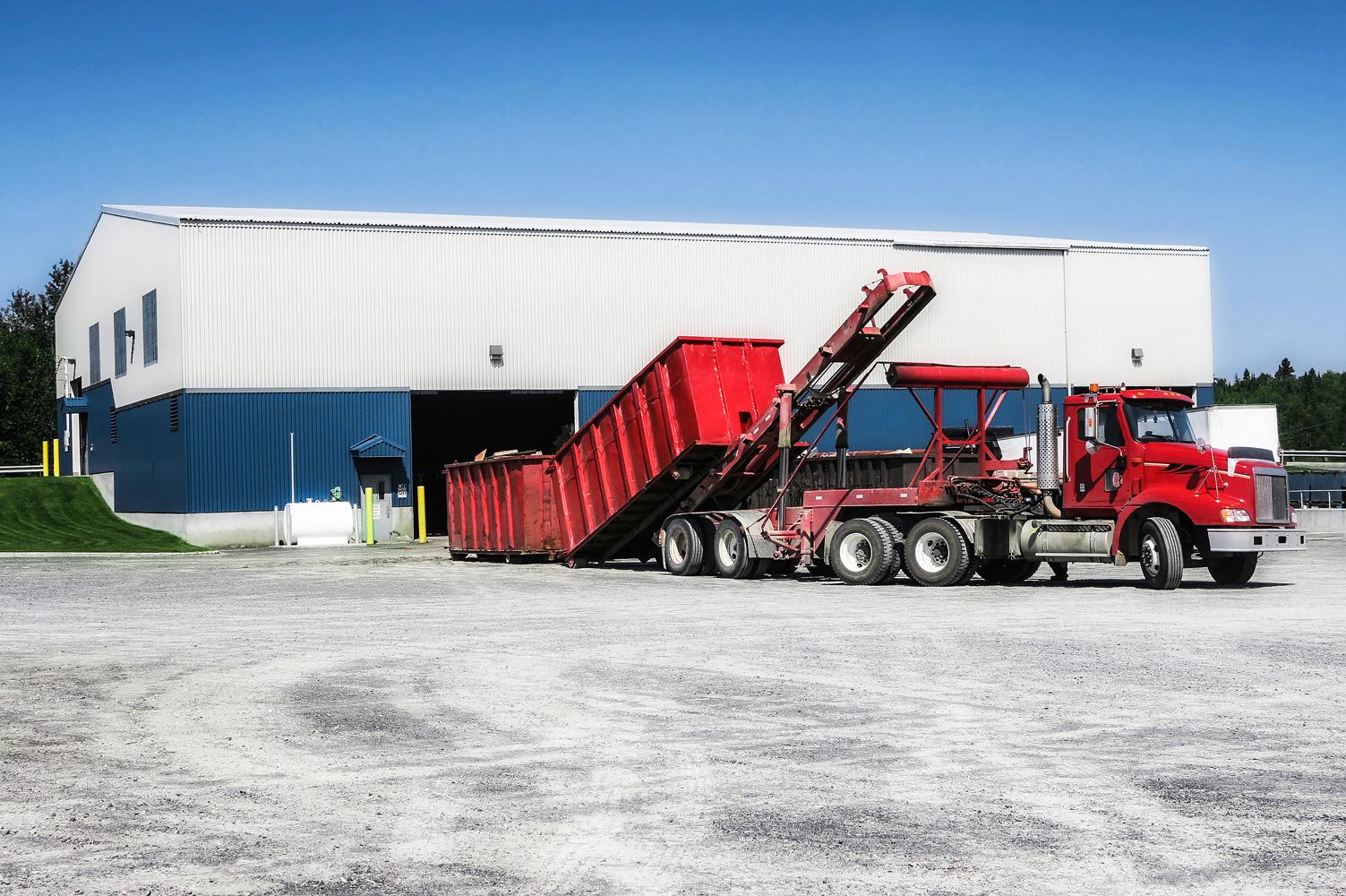 truck off-loading dumpster