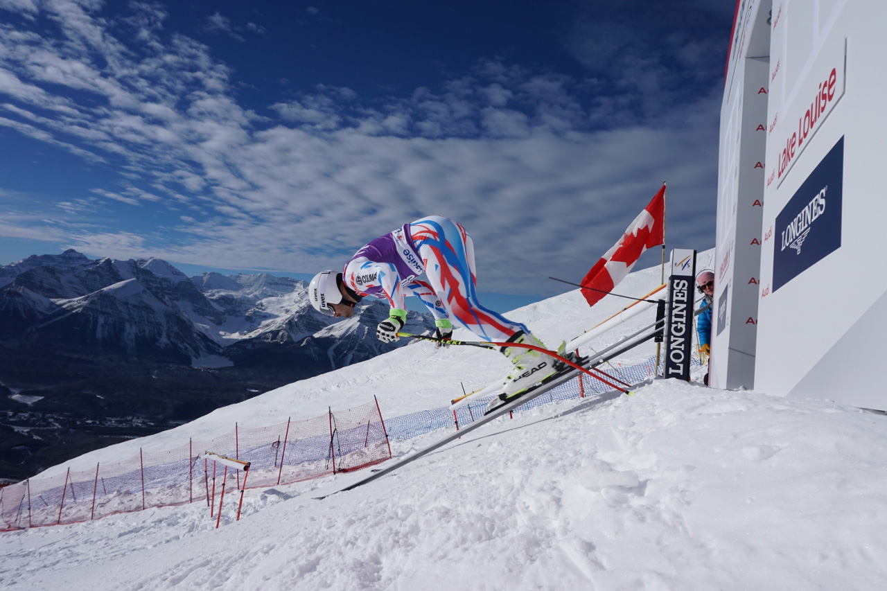 Competitive skier on snowy mountain slope