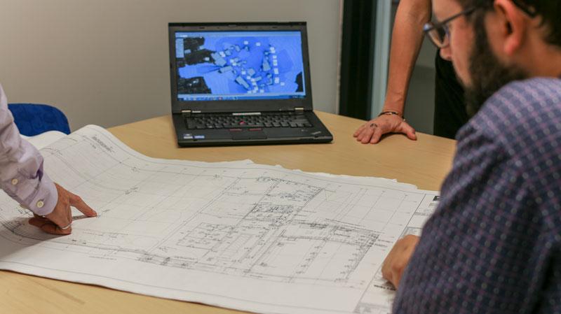 Engineers looking at building plans