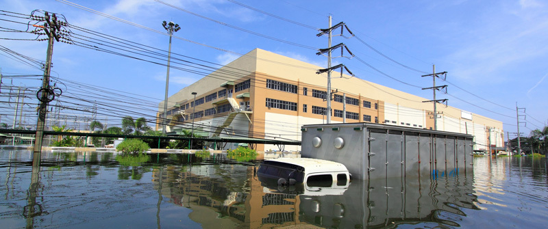 flooded area around building with submerged truck