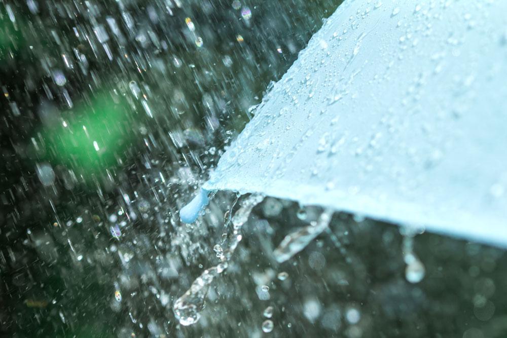 rain hitting side of umbrella