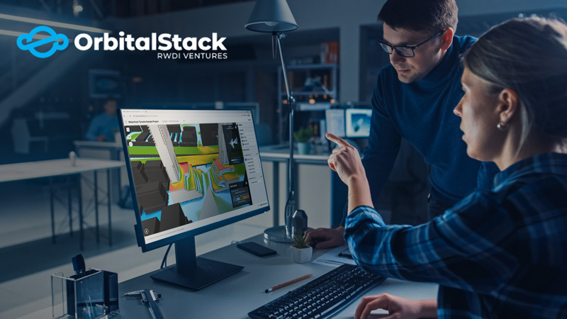 two people looking at Orbital Stack simulation on computer screen.