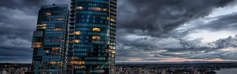 high rise and stormy sky