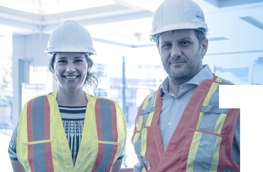 woman and man engineer in safety wear